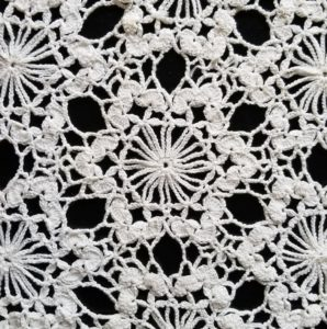 Crocheted tablecloth closeup
